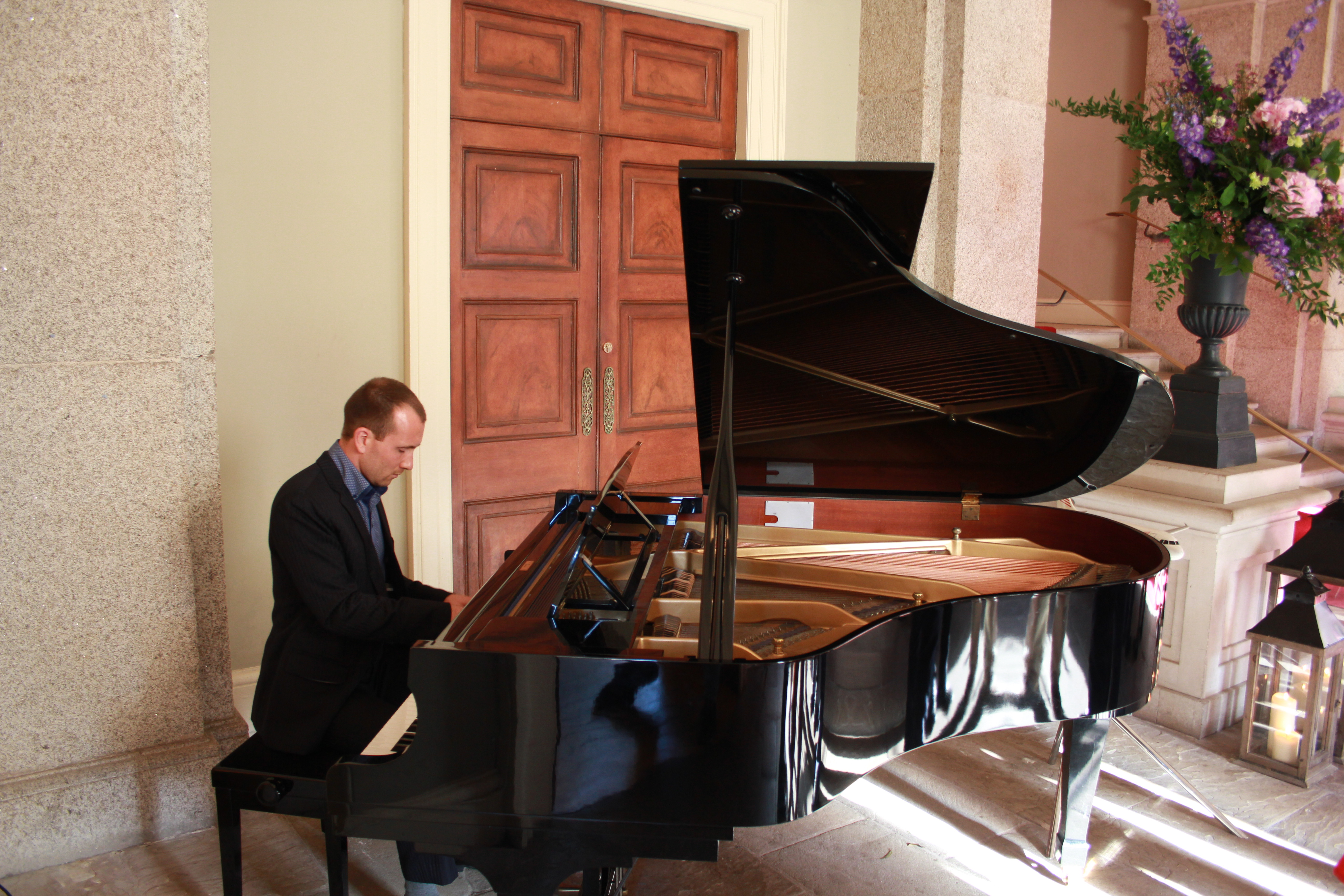 Joe Kenny Pianist playing grand piano at wedding drinks reception in Dublin