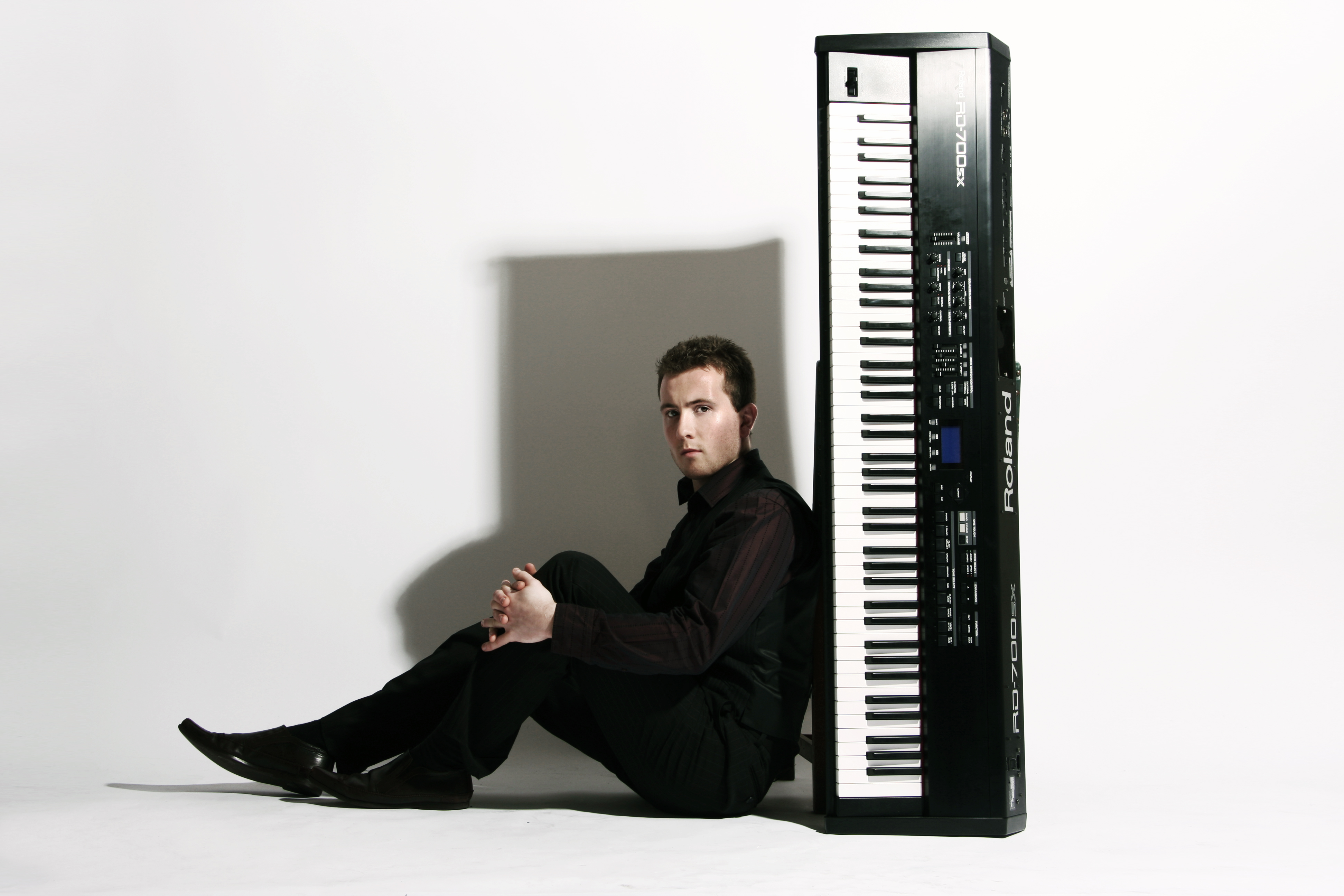 Joe Kenny Pianist with the keyboard used to play piano at weddings
